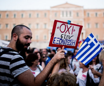 http://new-pretender.com/wp-content/uploads/2018/02/OXI_sign-greecereferendumdemojune2015.jpg